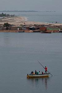This ferryman transports people continuously from the Ilha (island) to the mainland.  The people live in slums of corragated tin.  Rumor has it that this bay will be filled in to provide room for new coastal construction.