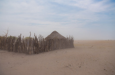 Botswana A village on the edge of the Kalahari near Makgadikgadi Pans Pans during a sand/dust storm.