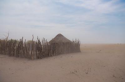 Botswana A village on the edge of the Kalahari near Makgadikgadi Pans Pans during a sand/dust storm.