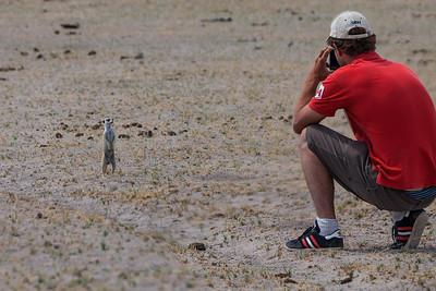 Makgadikgadi Pans, Botswana Andrew photographs a Meerkat