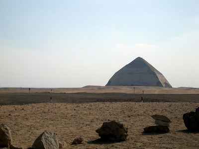 "The ""Bent Pyramid"" at Dashur. The first smooth-sided pyramid in Egypt. Building commenced at a steep angle, but it was unstable, so mid-way they changed to a shallower angle. Probably one of the most expensive engineering mistakes of all time."