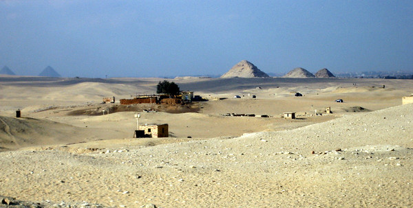View across the desert from Sakkara. The pyramids on the right are those at Abu Sir. The pyramids on the left are those at the Giza Plateau.