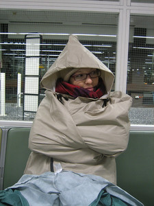 Rugging up to avoid hypothermia while waiting at Heathrow airport for our flight to Cairo.