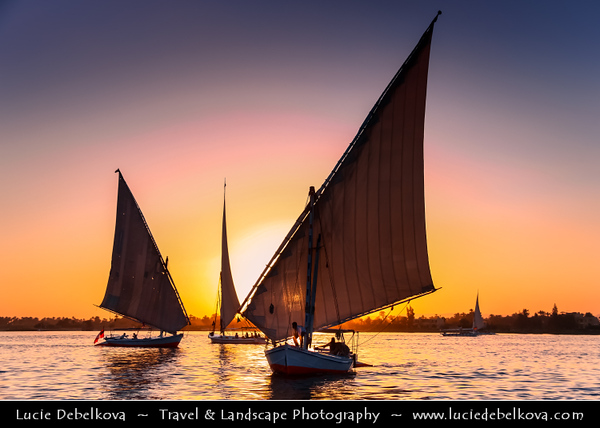 Egypt - Luxor - الأقصر - al-Uqṣur - Ancient Thebes - Θῆβαι - Thēbai - طيبة - UNESCO World Cultural Heritage site on banks of river Nile - Sailing in Felucca (boat) in the evening time