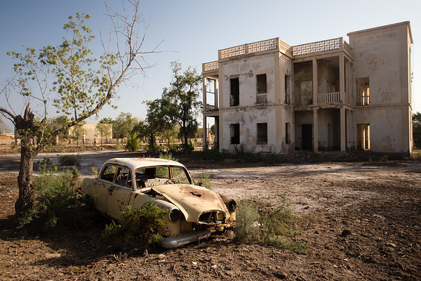 A car among the ruins of the town of Massawa on the Red Sea coast of eastern Eritrea.