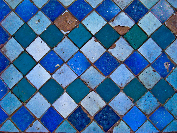 Closeup of the tiles on the graves inside the Saadian Tombs