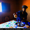 Northern Africa - Kingdom of Morocco - Sahara Desert - Zagora Province - M'Hamid El Ghizlane - Erg Lehoudi - Er Lihoudi - Local Bedouin in traditional blue dress drinking typical mint tea