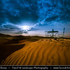 Northern Africa - Kingdom of Morocco - Sahara Desert - Zagora Province - M'Hamid El Ghizlane - Erg Lehoudi - Er Lihoudi - Classic desert landscape with constantly changing sand dunes, lines and shapes - Large sea of dunes formed by wind-blown sand - Night Sky with setting Moon