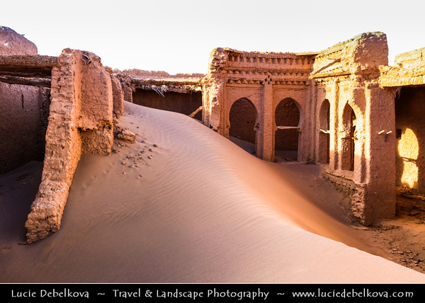 Northern Africa - Kingdom of Morocco - Sahara Desert - Zagora Province - M'Hamid El Ghizlane - Oulad Edriss - Ouled Idriss - Historical oasis town with traditional antique Kasbah, Ksar & Palmeraie covered in sand dunes