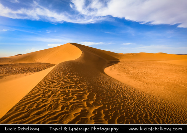 Northern Africa - Kingdom of Morocco - Sahara Desert - Zagora Province - M'Hamid El Ghizlane - Erg Lehoudi - Er Lihoudi - Classic desert landscape with constantly changing sand dunes, lines and shapes - Large sea of dunes formed by wind-blown sand