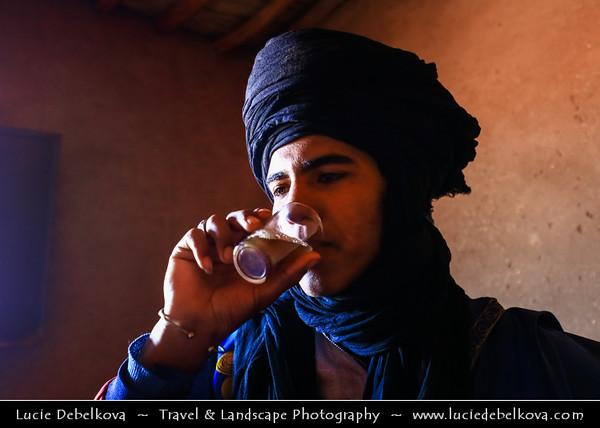 Northern Africa - Kingdom of Morocco - Sahara Desert - Zagora Province - M'Hamid El Ghizlane - Erg Lehoudi - Er Lihoudi - Local Bedouin in traditional blue dress drinking typical mint tea