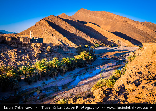 Northern Africa - Kingdom of Morocco - Souss-Massa Region - Tata Province - Tissint - Agadir Tissinnt - Agadir Tissint - Tissinnt - Historical village next to date palm valley with river forming small cascade (waterfall)