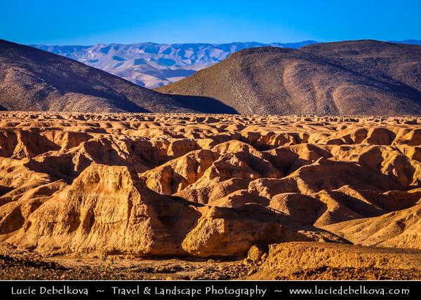 Northern Africa - Kingdom of Morocco - Souss-Massa Region - Tata Province - Tissint - Agadir Tissinnt - Agadir Tissint - Tissinnt - Desert wadi with dry riverbed escarpment with lunar like landscape