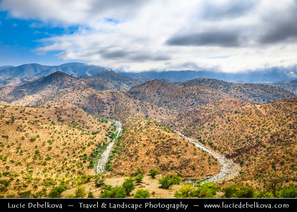 Northern Africa - Kingdom of Morocco - Souss-Massa Region - Chtouka Aït Baha Province - Spectacular mountain road between Ait Baha & Tizourgane in Anti-Atlas (Lesser Atlas, Little Atlas) hilly landscape with traditional villages and agadirs