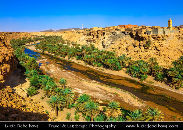Northern Africa - Kingdom of Morocco - Souss-Massa Region - Tata Province - Tissint - Agadir Tissinnt - Agadir Tissint - Tissinnt - Historical village next to date palm valley with river forming small cascade (waterfall)