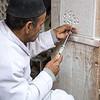 Man working on a souk of Marrakesh