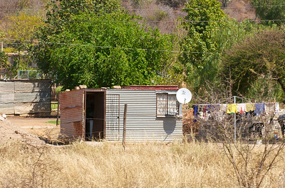 Hey, it may be a tin shack with no plumbing and a dirt floor, but it's got satellite TV.