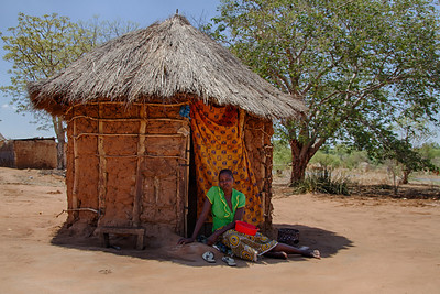 Village woman in front of her home