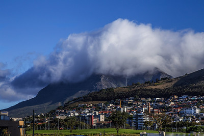 Cape Town, South Africa Table Mountain with a big frilly tablecloth on top.