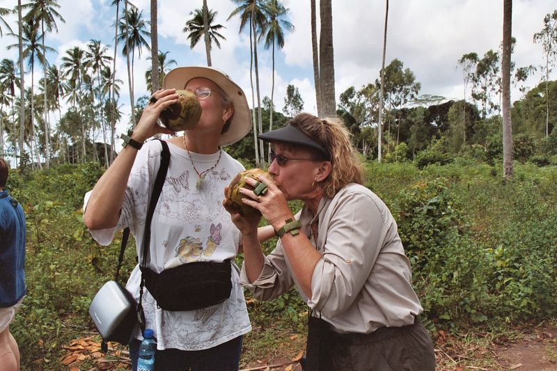 Linda and Eve Try Out Fresh Coconut Milk...More Like Coconut Water!