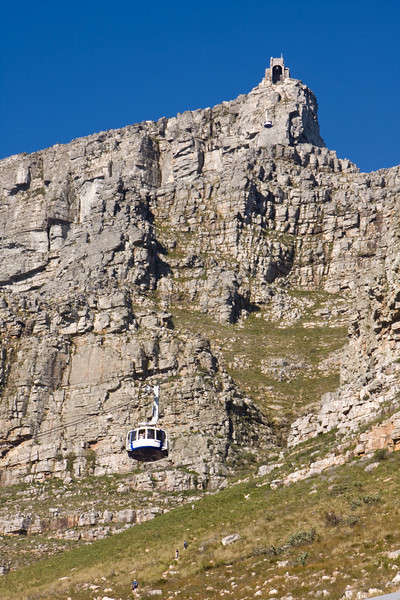 A view of a gondola ascending to the terminal at the top of Table Mountain. This is a landmark tourist attraction in Cape Town, South Africa.