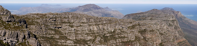 A panorama view of the Cape of Good Hope from the top of Table Mountain in Cape Town, South Africa. In the distance, the rugged mountains form the southwestern tip of the African continent.