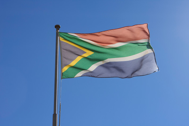 The flag of South Africa, flying in the wind over the Castle of Good Hope in Cape Town. The South African flag is the only one in the world to have six colors.