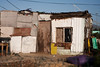 A fairly typical home in a South African township. These shacks are often built with whatever materials can be found.