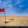 Northern Africa - Tunisia - Chott el Djerid - Large endorheic desert salt lake in southern Tunisia near towns of Kebili and Douz - Red sail Boat
