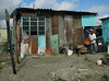 The houses are made of scraps of any available material; families retain their dignity but many are unemployed.