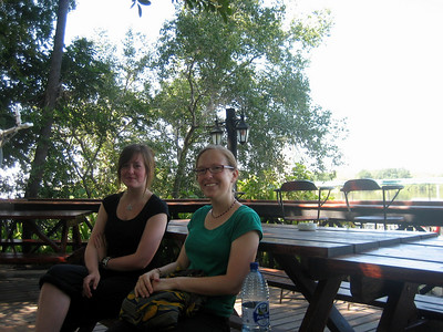 Lorna and Steph relaxing by the Zambezi river, Livingstone.