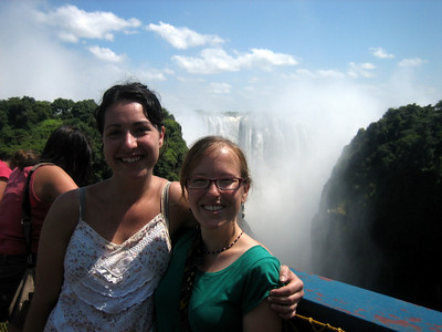 Charlotte and Steph on the bridge between Zam and Zim, with Vic falls behind.