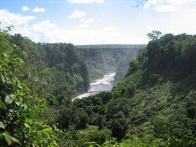 Looking down the Zambezi, away from the falls. The bridge pictured links Zambia to Zimbabwe.