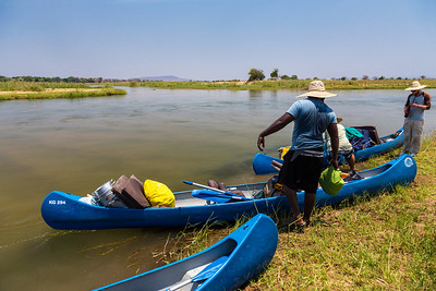 Lower Zambezi River, Zambia Unloading the canoes for lunch and afternoon siesta.