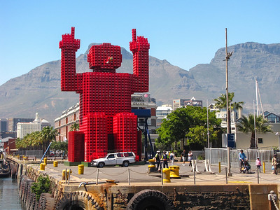 Elliot, the Coca Cola crate sculpture in the V&A Waterfront, with Table Mountain in the background.