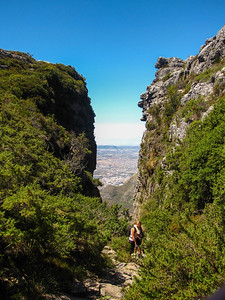 Gorge on Table Mountain, with climbers coming up the trail from the mountain's base.