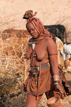 Himba mother, returning from milking goats, Namibia