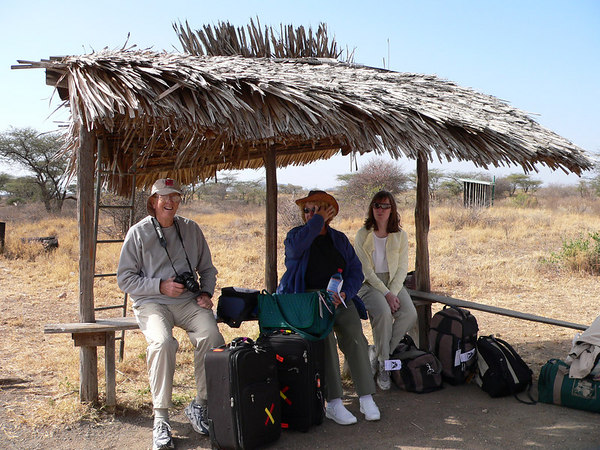 The airport lounge at Samburu.  My travelling buddies Bob and Tina Owens and my daughter Jennifer.  Note the first class restrooms in the background!
