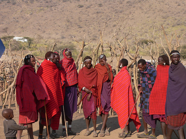 A group of Masai men preparing to do their traditional jumping competition.