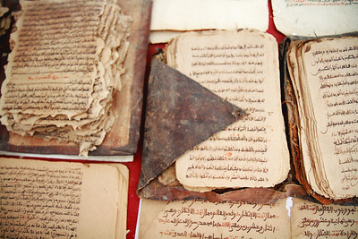12th century manuscripts at the Centre de Recherches Historiques Ahmed Baba in Timbuktu, Mali. The library contains more than 23,000 texts from all over the world. In January 2013, the library was burned to the ground by insurgents.