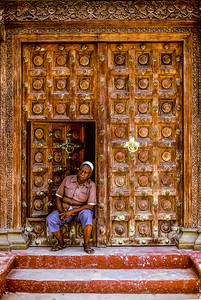 Old man in doorway of Jamatkhana