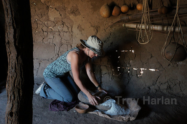 Julie grinding flour