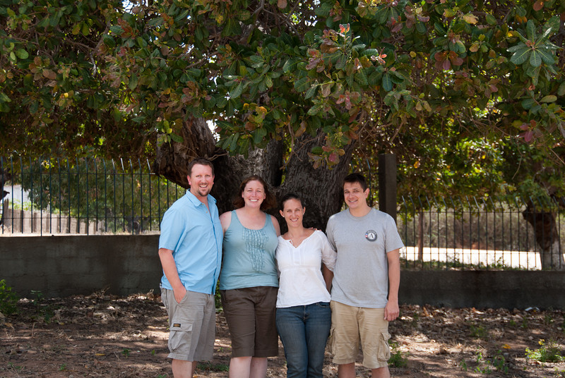 "<span id=""title"">Group Photo</span> Here's my wife and I with our friends in the Peace Corps. We took the photo right outside their house just before we left for the airport."