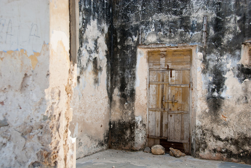 """<span id=""""title"""">Old Door</span> A ruined building along the main road in the baixa."""