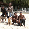 "<span id=""title"">Kids and Dogs</span> These kids also saw the camera and wanted their photo taken with their dogs. Too bad the kid on the left was busy with canine management."