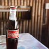 "<span id=""title"">Coca-Cola</span> I found it interesting that when you get a soda in Pemba, you're only buying the liquid. The shop or restaurant owner takes the bottle back and exchanges them for filled bottles. Everything is glass, and every bottle we got had obviously been used before."