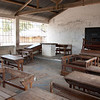 """<span id=""""title"""">Classroom</span> Although the doors were locked (it was Sunday), we peeked into this 2-room neighborhood primary school. It's sad to see how few resources they have."""