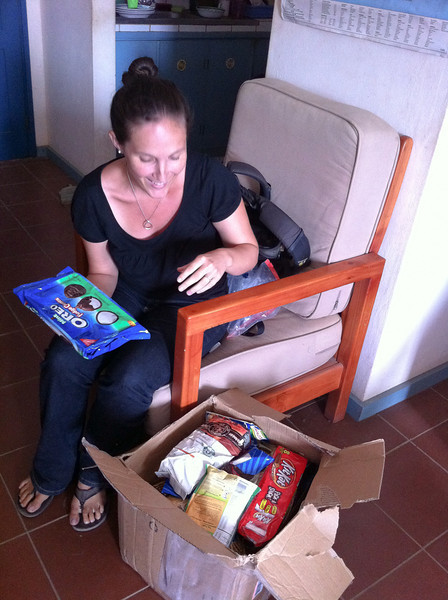 """<span id=""""title"""">Care Package</span> I think we got a real feel for the Peace Corps experience when our friends received a care package from one of their moms the last day we were there. As a bonus, the package was hand-delivered to their house. As you can see, it was filled with tasty goodies."""