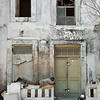 """<span id=""""title"""">Resting</span> Two men taking a siesta in front of an old building."""