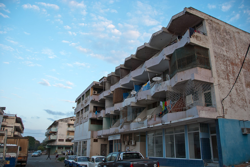 """<span id=""""title"""">Apartment Building</span> An apartment building near the center of downtown Pemba. The various 'cages' surrounding some of the balconies were very interesting to see."""